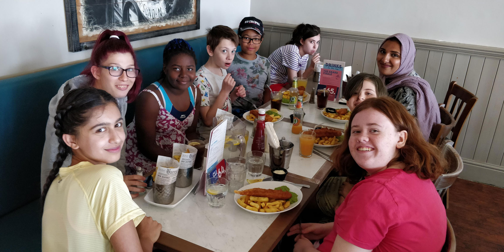 Young carers enjoying Fish and Chips at the seaside