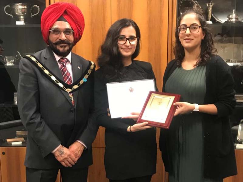 photo of the Worshipful the Mayor of Slough, Paul Sohail and Cllr Pavitar Mann present Aneesa Hussain with an award recognising Slough Young Carers' awareness-raising work